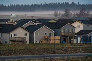 Houses in Foggy Morning Light